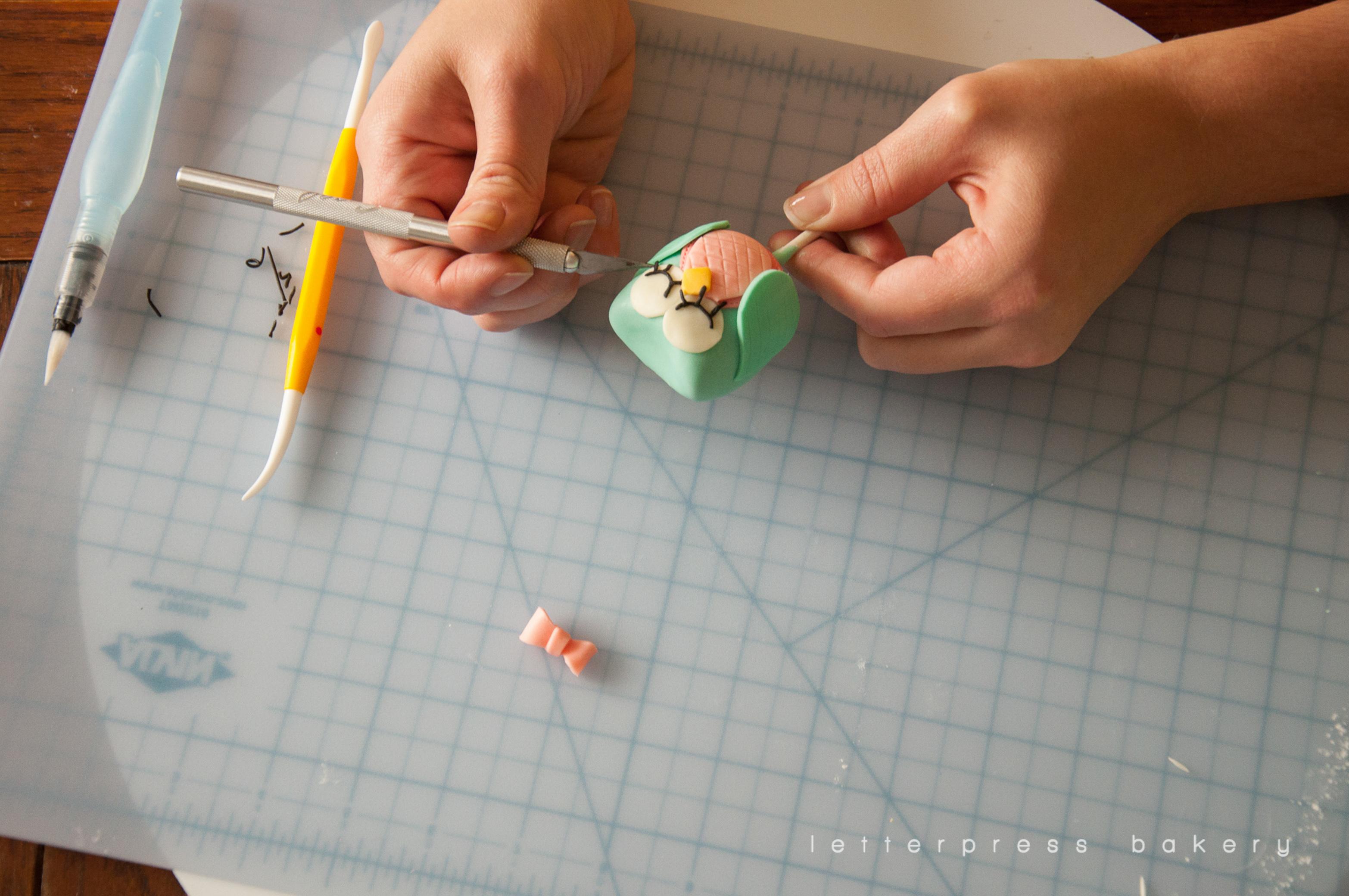 Adding eyelashes to make it a girl