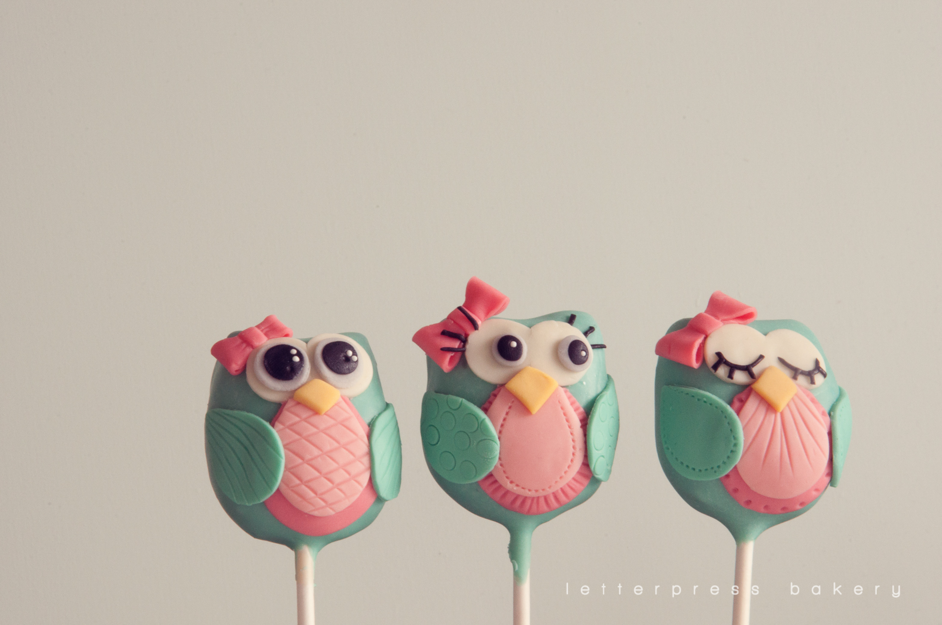 With pink bows and accents girl owl cake pops