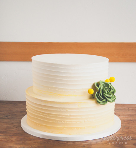 Rustic buttercream yellow ombre wedding cake
