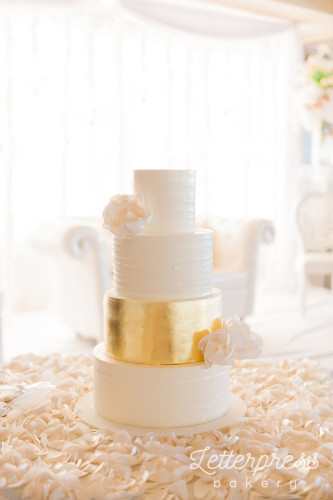 Rustic Buttercream wedding cake with gold tier and sugar rosses