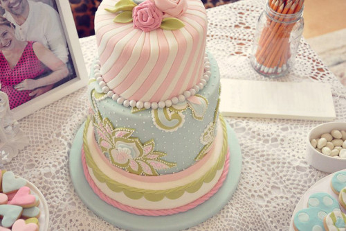 Soft pinks, teal and green baby girl shower cake