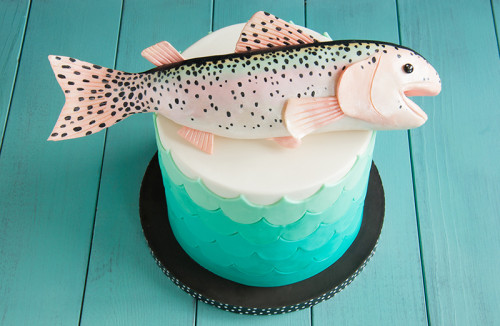 Teal waves birthday cake with trout topper