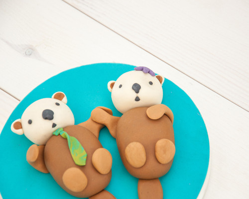 Otter wedding cake toppers for west coast wedding