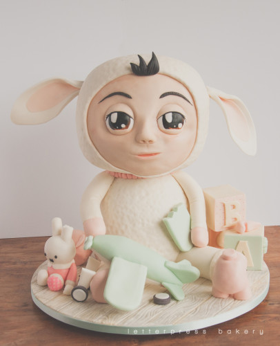 100 days baby girl in lamb costume 3D carved cake
