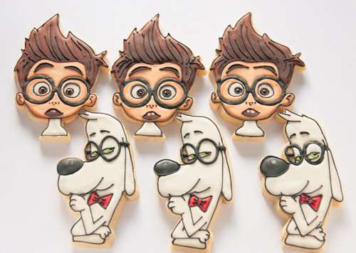 Character decorated sugar cookies in the shape of Mr. Peabody and Sherman