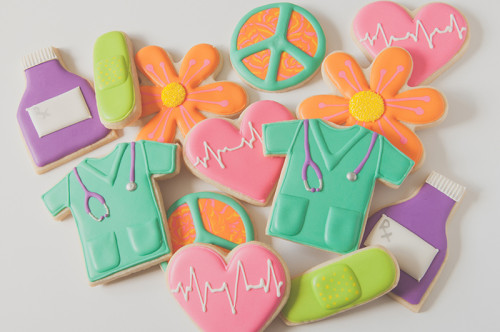 Scrubs, heart rate, medicine, pill bottle, bandaid, peace sign and flower cookies for nurse