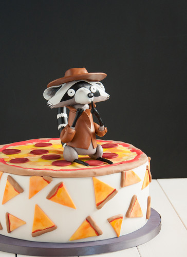 Pizza party cake with Raccoon topper.