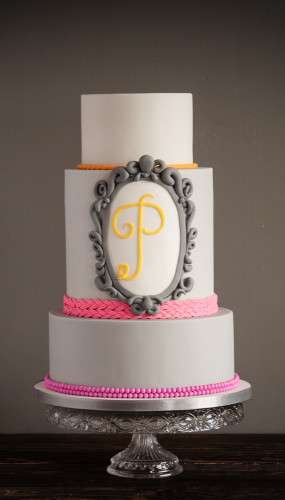 Neutral grey with neon pinks wedding cake with large frame