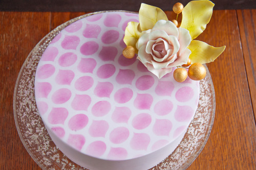 Purple stencilled cake with mauve gum paste rose and gold accents