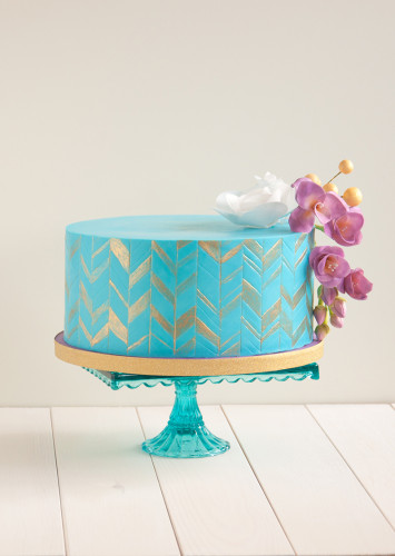 Purple Freesias on a funky cold and teal chevron birthday cake