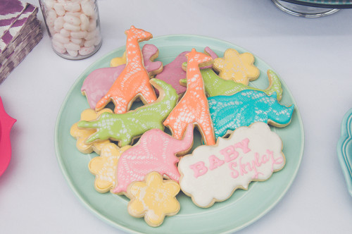Shimmery lace effect airbrushed onto alligator, giraffe, rhino, elephant and hippo cookies