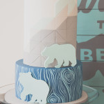Geometric cake design with black bear cutouts.