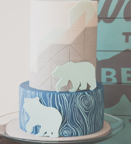 Geometric cake design with black bear cutouts.