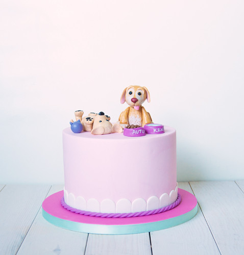 Pink cake with puppy toppers