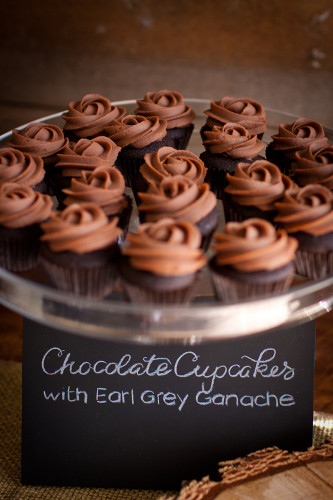 Mini chocolate cupcakes with piped earl grey infused chocolate ganache