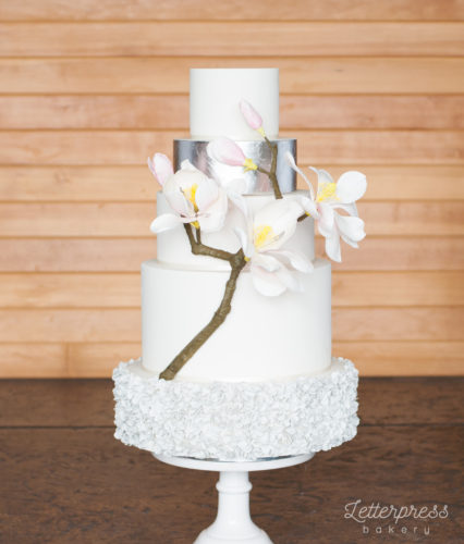 5 tier wedding cake, grey ruffles, silver leaf and gumpaste magnolia branch, magnolia flowers and buds