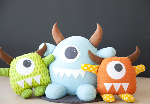 Blue monster stuffy cake with his green and orange stuffy friends