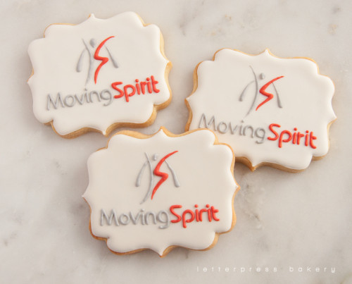 Decorated royal icing sugar cookies with Moving Spirit logo