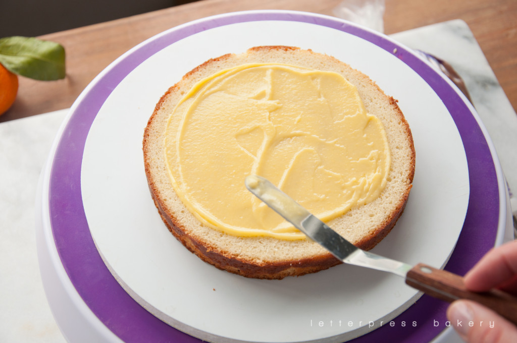 Tangerine curd spread on first layer