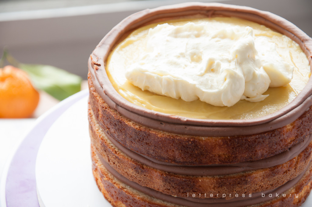 Cream cheese icing inside chocolate ganache border