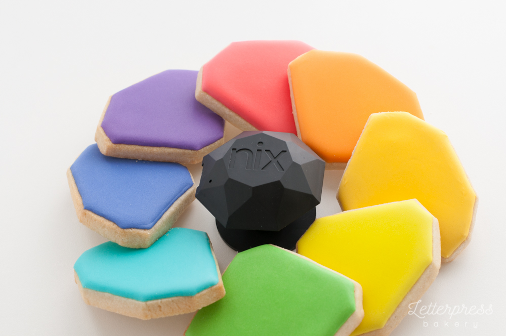 Nix Sensor Pro surrounded by a rainbow of cookies