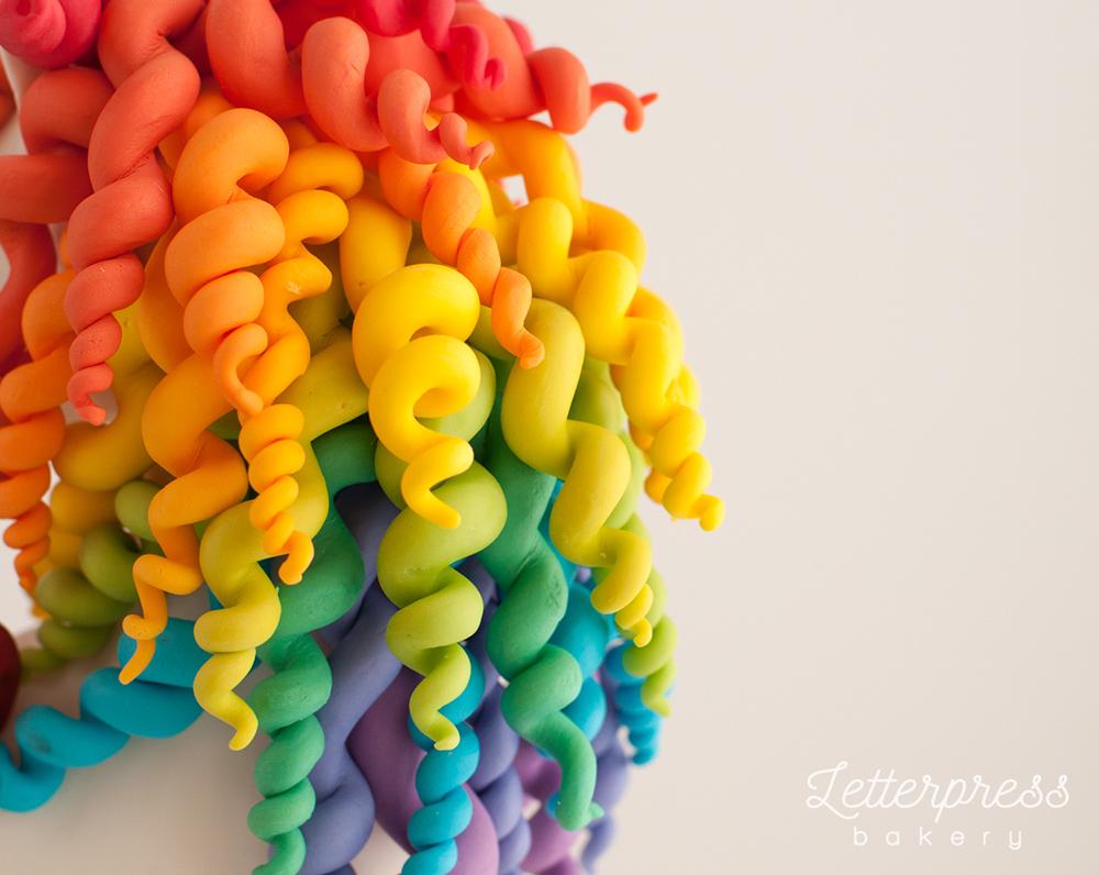 Rainbow of curly unicorn hair