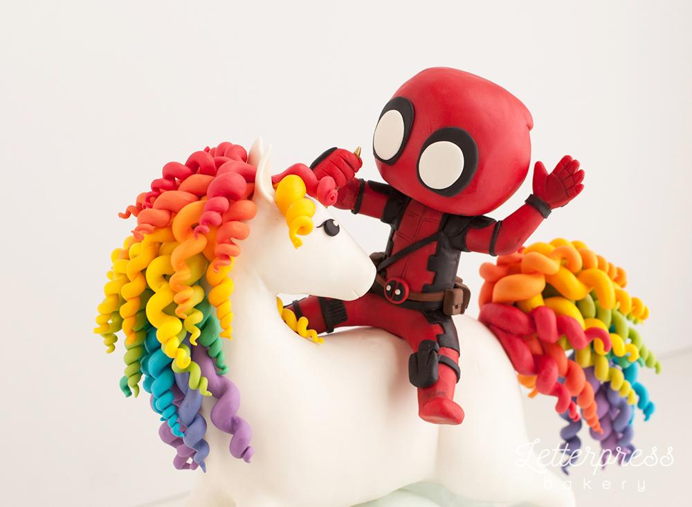 Little deadpool cake riding his rainbow unicorn