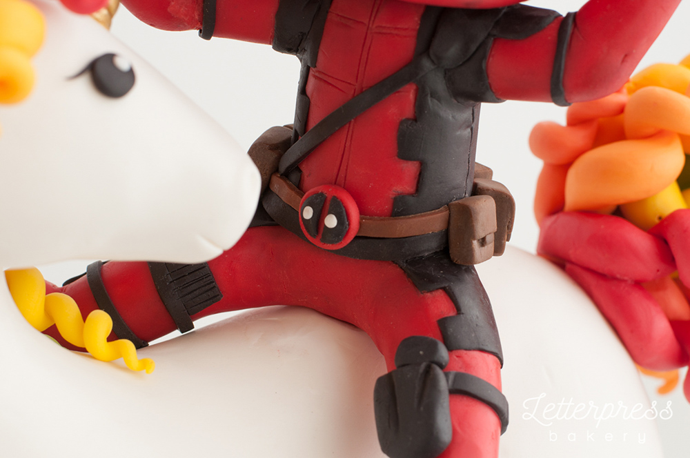 Deadpool cake details, his belt and buckle